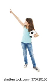 A young girl holding football, pointing. Isolated on white background
