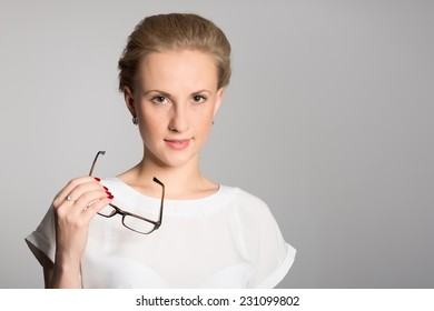 Young girl holding glasses in hand