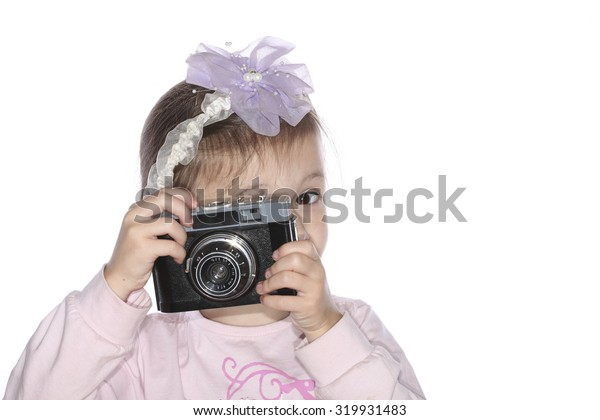 Young girl holding old camera isolated on white background