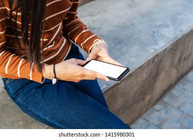 Young girl holding phone new app technology in the city, Asian pretty girl.