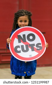 A young girl holding a placard against Government austerity measures during a May Day demonstration in the city of Salford in the north west of England on May 5th, 2014.