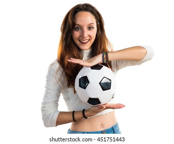 Young girl holding a soccer ball