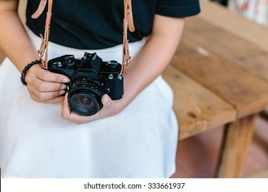 young girl holding vintage film camera