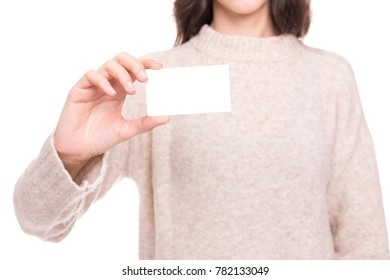 Young girl holding a white card on a white background