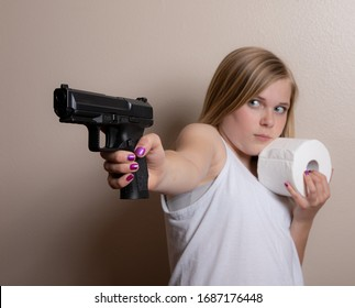 Young girl holds a gun in one hand and her toilet paper in the other