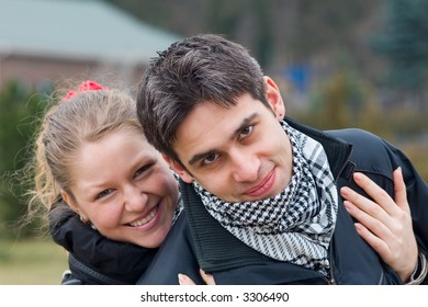 Young girl hugs a young man, diagonal image