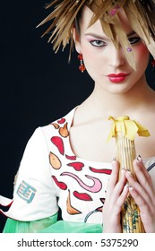 Young girl in japanese clothing on the black