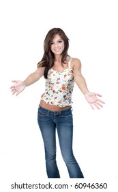 Young girl in jeans and flower print top,  with her arms outstretched as if she is ready to hug someone. Shot against a white background.