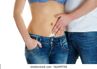 young girl in jeans and a naked stomach  man touching her  paying  the money