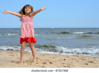 Young girl jumping on the beach