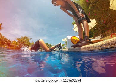 Young girl jumping in swimming pool against No jumping sign on summer holidays.