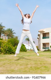 young girl jumping in a white
