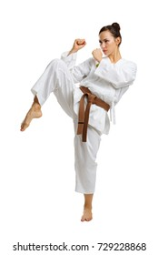 A young girl in a karate pose. Isolated on white background.