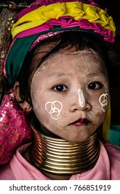 Young girl kayan with her long neck - 2015 Chiang Rai, Thailand.