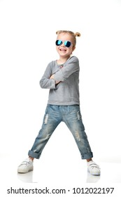Young girl kid standing in blue aviator sunglasses happy smiling laughing isolated on a white background