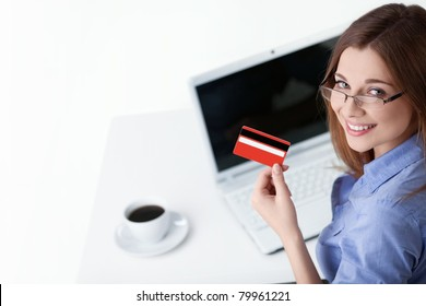 Young girl with laptop and credit card