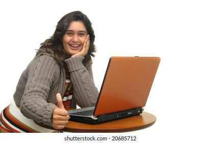 Young girl with laptop isolated against a white background