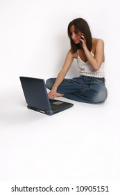 young girl with laptop talking on a cellphone