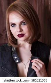 young girl in a leather jacket on a naked body