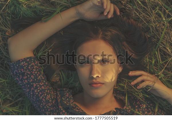 young-girl-lies-grass-her-600w-177750551