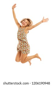 Young girl in a light dress and barefoot in a jump, isolated on white background