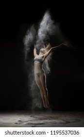 Young girl in lingerie in white dust cloud