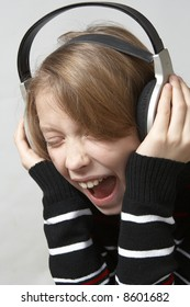 Young girl listening to the music with headphones