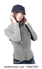 Young Girl listening music in headphones, isolated on white background, model is a asian beauty