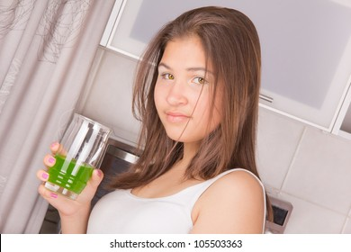 Young girl with long hair, eat breakfast in the kitchen