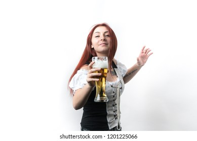 A young girl with long red hair in a traditional German corset advertises a golden beer in a glass