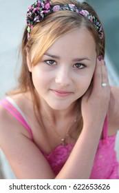 young girl looking at camera outside shoot