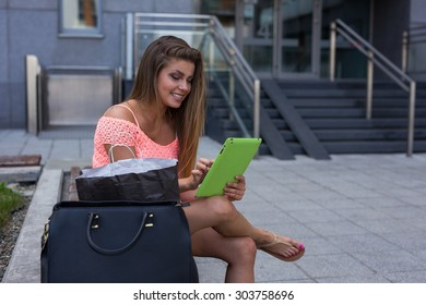 Young girl looking for new sales using her tablet