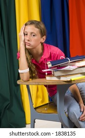 Young girl looking overwhelmed or bored by school or homework