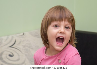 Young girl looking with a shock expression