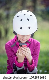 Young girl looking at smartphone.
