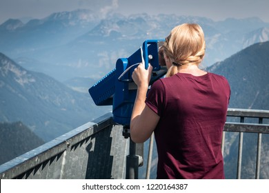 Young girl looking to the telescope