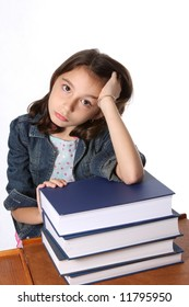 Young girl looking thoughtful leaning on stack of books
