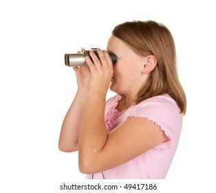 young girl looking through binoculars on white