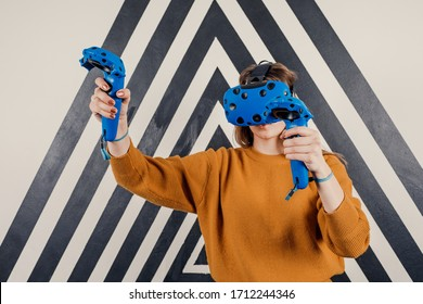 A young girl looks into virtual reality glasses