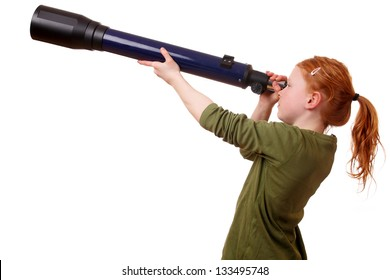 Young girl looks through a telescope on white background