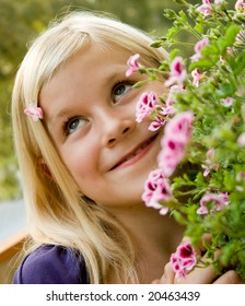 A young girl loving flowers