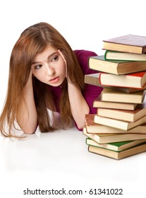 Young girl is lying on a floor with books. Isolated on white background