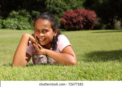 Young girl lying on the grass relaxing