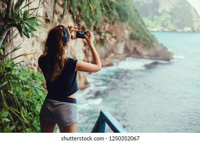 Young girl make photo in smartphone camera, digital frame, social blogger, outdoor hipster portrait, travel woman, paradise island, ocean, freedom