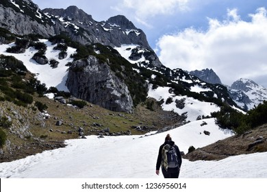 Young girl make trekking in Durmitor national park. Mountains, near Bobotov Kuk. Montenegro.