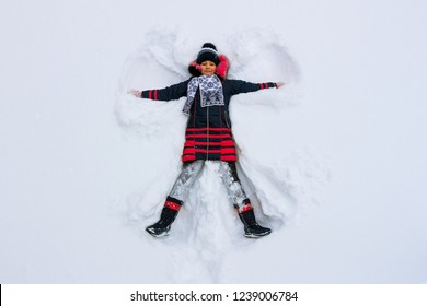 Young Girl Makes a Snow Angel