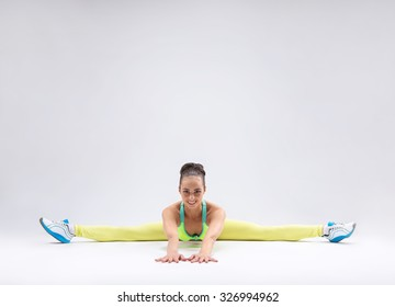 Young girl makes stretching in the studio