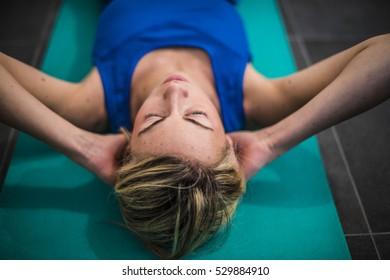 young girl making abdominal, stretching and weight for arms for fitness