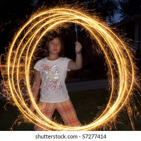 Young girl making circles with a sparkler