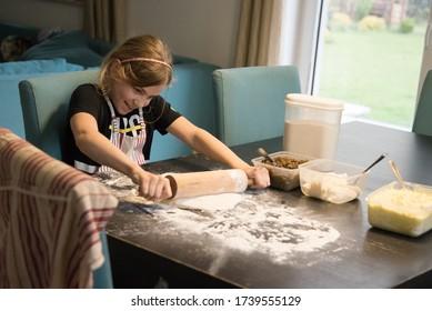 Young girl making a dough